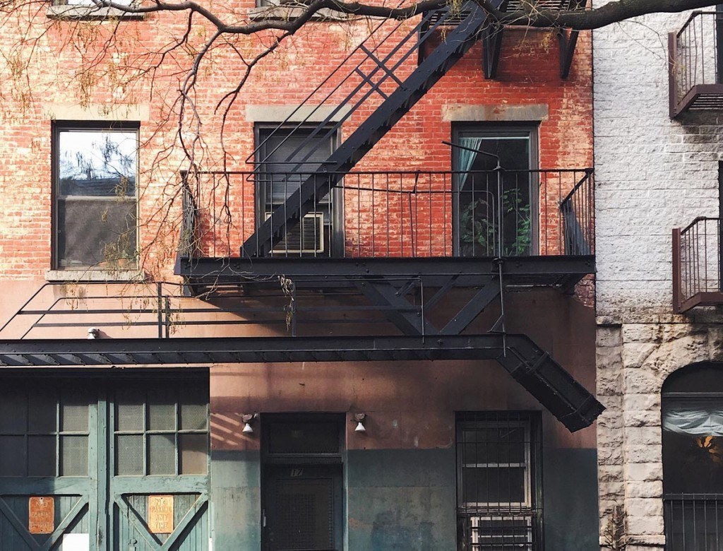 an older town building with a fire escape