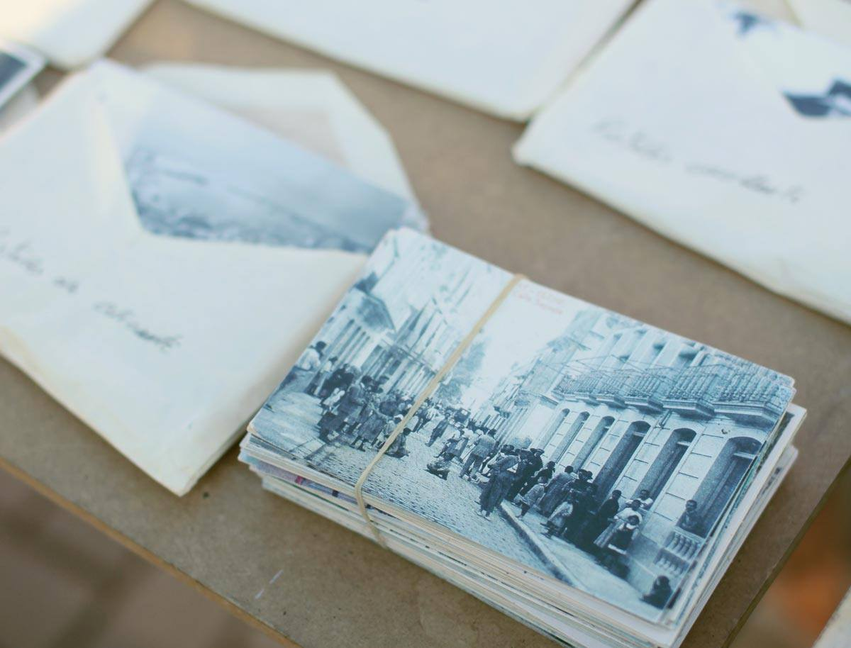 old letters filled with black and white photographs