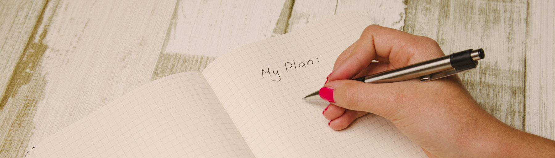 "woman writing in a note pad ""My Plan"""